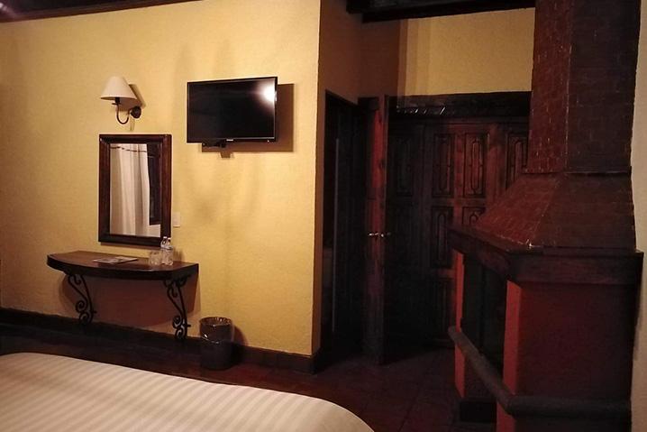 Hosteria san Felipe habitacion doble chimenea 2